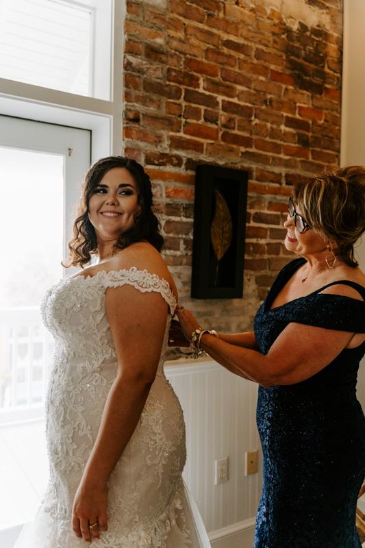 Mom Helping Bride Put Dress On